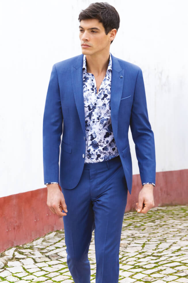 Man wearing suit with floral shirt